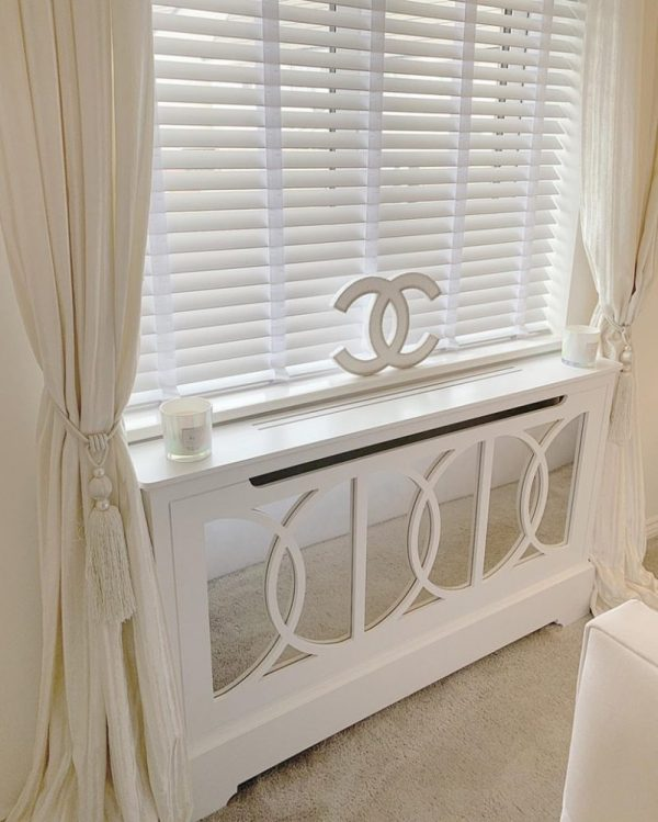 Mirrored_radiator-cabinet_under_window